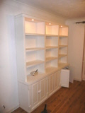 A whole wall of book/storage shelves